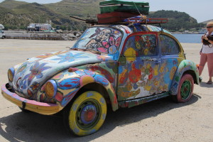 """""""The Trip is the Expansion of the Spirit"""" caption on these wonderful artist created cars."""