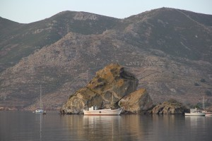 Grikos Harbor photo.  Hermits used to live in this rocky promintory in the sea.