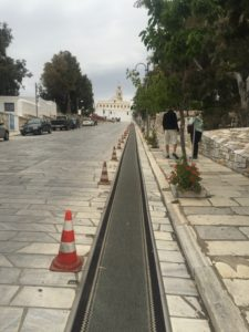 Rubber path  to Church of the Annunciation - Pilgrims crawl up the path to the church with a long candle.