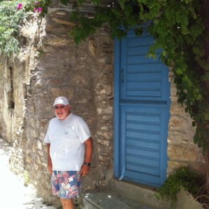 Tom enjoying the beauty of an old arch and shuttered window on the streets of Volax on Tinos.